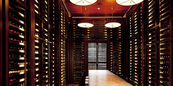 Photo of elegant, well-stocked wine cellar