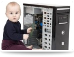 Infant playing with computer